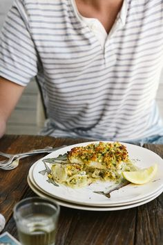 From The Kitchen: Flaky Baked Fish with Crunchy Pine-Nut & Herb Topping on a bed of Sweet Fennel