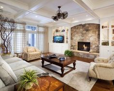 built in shelving and stone fireplace warm and inviting room
