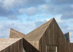Sand dune-inspired kindergarten completed by Dorte Mandrup beside a Swedish beach.