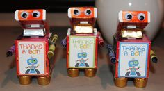 Thanks-A-Bot party favors.  Mini slinkies, Rolos, mini Hershey bars, crayons and orange tic tacs.  Please adopt-a-bot on your way out! - Robot Birthday Party #robot #robotparty #partyfavors