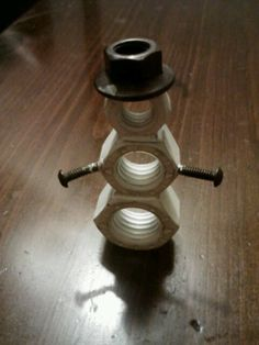 Snowman welded from nuts and things. This would be cute for holiday decor