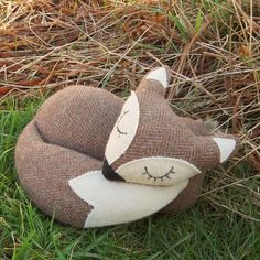 A snoozy fox doorstop.  Made from a tactile herringbone wool. £27.00