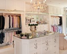 amazing closet space. I would have lots of girly fun in here all by my lonesome. Playing dress up and trying on new looks and experimenting...good stuff. :)