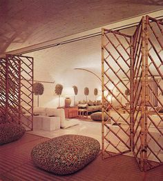 barrel vaulted ceiling + bamboo folding screens on a track (Valentino's NY…