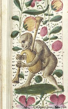 Breviary, M.463 fol. 609v - France, possibly Toulouse, ca. 1490 - Margin is decorated with floreate border, including daisies and violas, inhabited by monkey, playing bagpipe