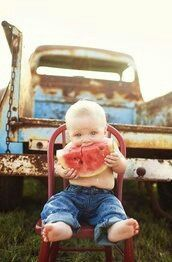 Country kid and his watermelon... Yum!