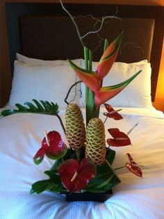 Ginger flowers, anthurium, heliconia, curly willow, and tropical foliage. By Watanabe Floral in Honolulu.