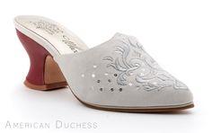 American Duchess custom made 18th century mules for Whoopi Goldberg.  Find similar 18th century mules at http://www.american-duchess.com/shoes-18th-century