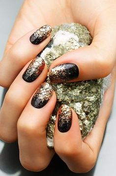 black and gold oval nails