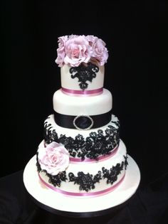 Pink and Black Vintage Lace 4-tier Wedding Cake. As displayed at Squires Kitchen Wedding Cake Showroom at their National Annual Exhibition.
