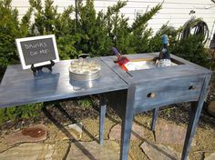 Old sewing machine table to bar/drink cart. Fantastic repurpose!