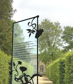 transparent resin or glossy glass with black silhouette text and imagery
