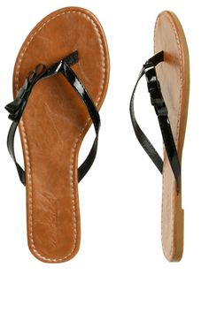 Flip-flops can be chic if you pick a minimalist, elegant pair – and style appropriately!