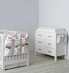 This 100% cotton storage collection is essential to any nursery. That's because it features easy-to-coordinate grey/blue embroidered details that match with nearly any nursery décor. The Changing Table Runner features three roomy pockets to fit tons of baby must-haves. And the wall hanger can also be hung on the end of a crib for added convenience.