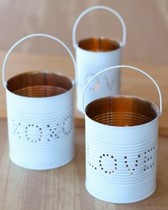 Learn how to make an adorable tin lantern from an upcycled tin can! These easy DIY lanterns are made from just two recycled craft supplies: a tin can and a wire coat hanger. Perfect for rustic wedding or Valentines Day.