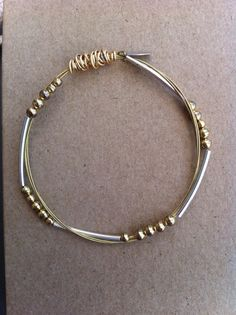 guitar string bracelet guitar string bangle by PaperMacheJewelry, $18.00