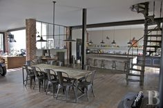 Vintage tolix chairs, reclaimed wood, industrial style bar stools and enamel pendant lights