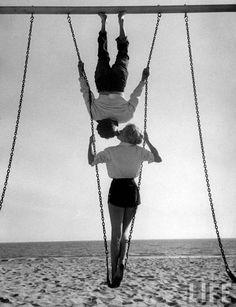 Acrobat and actor, Russ Tamblyn, on the beach with movie actress Venetia Stevenson. Venice Beach, 1955