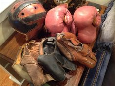 Vintage Sporting equiptment. Baseball and boxing gloves with football helmet.  #onemansalvage