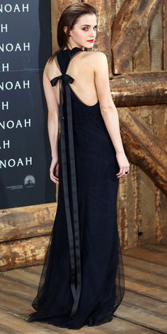 At the Berlin premiere of Noah, Emma Watson turned heads in a navy-and-black tulle chiffon Wes Gordon racerback gown, tied with a floor-length bow at the back. To avoid drawing attention elsewhere, she kept accessories to a minimum, save for black Ana Khouri studs.