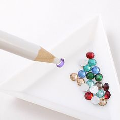 Rhinestones Pick Up Pencil / Rhinestones Grabber / Gem Picking Tool - for Cellphone Deco Jewelry Making Nail Decoration. $1.25, via Etsy.