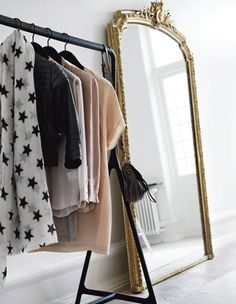 just a room, a huge gold antique mirror and racks of clothes ... dream closet for sure #closets