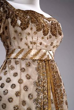 Princess d'Eckmühl Ceremonial Dress and Train, (born Louise-Aimée-Julie Leclerc) Wife of Maréchal Davout.  Worn on the occasion of the imperial wedding. Made from tulle and ivory silk satin, these two items are finely embroidered with gold and platinum thread, featuring flower seedling designs on the central body of the dress and plant wreathes on the borders.