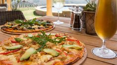 You have to try our pizzas at The Bellevue Restaurant (The Village Lodge)