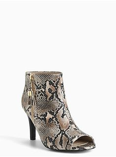 """These faux snake skin peep toe booties did not come to play, they came to slay with a sassy zip side embellished with """"fancier than you"""" tassels.<div><ul><li style=""""list-style-position: inside !important; list-style-type: disc !important"""">TRUE WIDE WIDTH: Designed so you never have to size up again. For the perfect fit, we recommend going down a whole size.</li><li style=""""list-style-position: inside !important; list-style-type: disc !important"""">3.75"""" heel</li><li style=""""list-style-position…"""