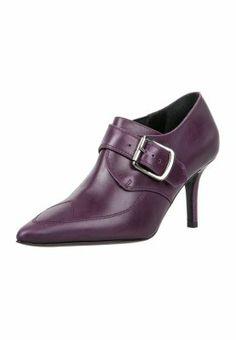 Vivienne Westwood http://pixiie.net/shop/vivienne-westwood-accessories-high-heels-purple/