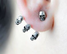 "- One Skull Stud w/ Three Wrap Around Skull Earrings - You get a pair of earring (2) one for each ear. - Each Skull is .25"" - Pewter Metal - UNISEX - Great for Men or Women - Surgical Steel / hypoallergenic Post Base"