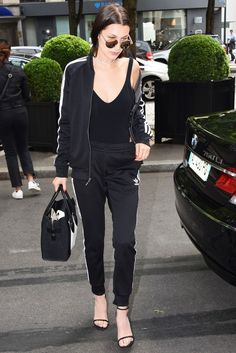 Bella Hadid is clearly on board with the latest trend of track suits.  The young model recently stepped out in an Adidas track suit worn over a body suit with a pair of strappy heels