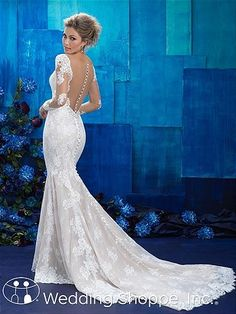 Allure 9424: A long sleeve lace wedding dress with illusion back.
