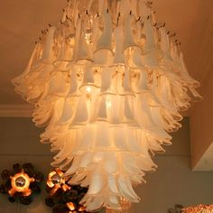 FROU FROU CHANDELIER  Magnificent, 1970s, Italian, hand-blown glass chandelier covered in clear glass 'petals' each with a 'splurge' of white glaze - absolutely stunning.