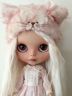 White hair blythe. Blythe doll with wool cap