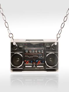 80s Boombox Necklace    This lightweight pendant has a high-gloss, domed appearance on opaque acrylic. Necklaces are available on a silver-tone