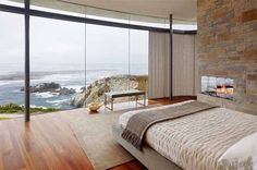 Amazing ocean view bedroom with fireplace overlooking gorgeous rocky cove.