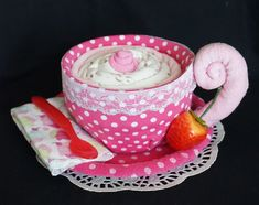 Tea Cup Baby Gift containing 1 sleeper, 1 beanie cap, 1pair of socks, 3 infant washcloths and 1 baby spoon. www.facebook.com/DiaperCakesbyDiana