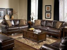 This has a lot of what we have to work with, dark brown leather couches and dark floors. So light beige-ish walls and black curtains? Who knew!?! Looks good. by jeanine