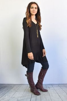 An extra long length makes this cool tunic perfect for layering over leggings.  Comfortable clothes have a place in every wardrobe.  This tunic gives you freedom to move, no matter what the occasion. When you don't feel like fussing with body-conscious tops and tees, throw on this roomy yet draped with elegance and breath a stylish sigh of relief.