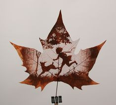Leaf Carving: Carved from a chinar leaf which has been dried and cured.