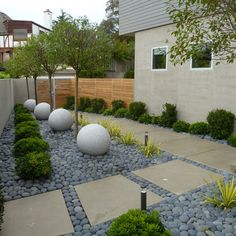 contemporary landscape/yard with 0.4 cu. ft. mexican beach pebbles