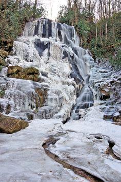 Eastatoe Falls, frozen waterfall in the North Carolina mountains near Asheville.