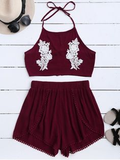 Lace Floral Halter Crop Top and Shorts - WINE RED S Summer beach two piece suit with crop top and tulip shorts. Features: Halter collarline Lace flower appliqued at the breast Zip up design at back Sexy crop top Tulip like shorts Fringe hem Style: Casual Material: Polyester Fit Type: Regular Waist Type: Mid Closure Type: Elastic Waist Front Style: Pleated Pattern Type: Solid Weight: 0.2600kg Package: 1 x Tank Top 1 x Shorts