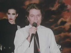 Robert Palmer-Addicted to Love..                      http://www.youtube.com/watch?v=XcATvu5f9vE