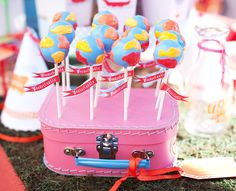 Adorable globe cake pops in suitcase holder. Would be fun for some sort of bon voyage!