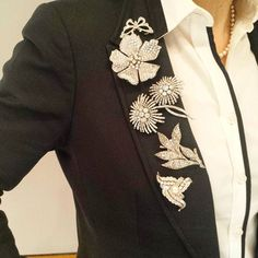 This is how we wear brooches on a tuxedo jacket.  Highlights from Christie's JewelsOnline auction