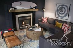 Thanks to @camillahouseltd for supplying Jon and Kate's fabulous vacation home with these beautiful furnishings that just ooze 'waterfront property'. We love how the #incomeproperty design team continues to think #outsidethebox by using this surf board as a centerpiece to complete this cozy living room. #IncomeProperty @scottmcg