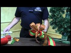 Kevin from Trees n Trends will show you how to tie a beautiful bow out of decorative ribbon.  You can find all of the supplies needed for this project at our Trees n Trends stores!  Trees n Trends - Unique Home Decor.  Follow us on Facebook at http://www.facebook.com/treesntrends  Visit our website at http://www.treesntrends.com