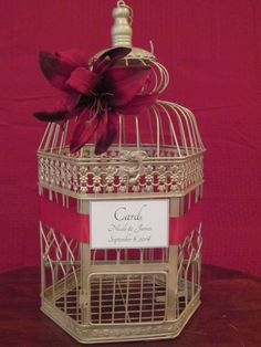#birdcageweddingcardholder #weddingcardholder #weddingbirdcage http://theweddingdecorplace.theweddingmile.com/items/details/88105-champagne-birdcage-card-box-with-red-tiger-lillies-wedding-card-holder